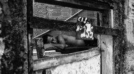 Obyvatelia slumov...